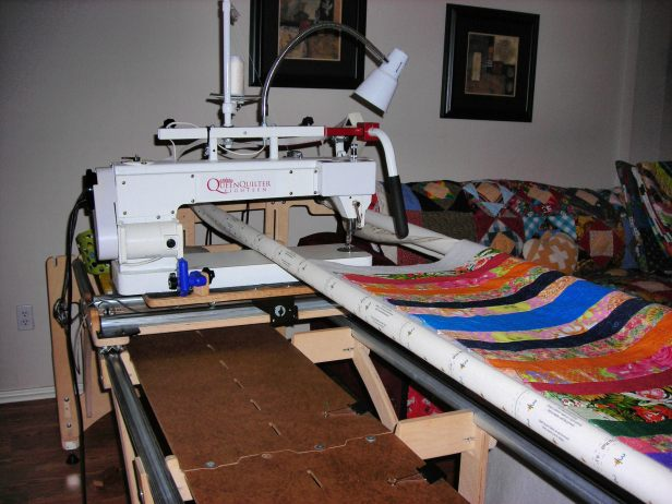 Long arm quilter with frame